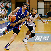 Istanbul BSB's Zack Wright (R) and Anadolu Efes's Matthew Janning (L) during their Turkish Basketball League match Istanbul BSB between Anadolu Efes at Cebeci Arena in Istanbul Turkey on Monday 09 March 2015. Photo by Aykut AKICI/TURKPIX