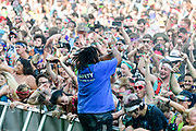 A security guard sprays the rocking crowd with water during The Bonnaroo Music and Arts Festival
