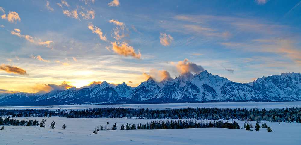 Open Edition Panoramic Prints<br /> Teton Mountains Range in sub zero winter temperatures and a Golden Warm Sunset along the Snake River