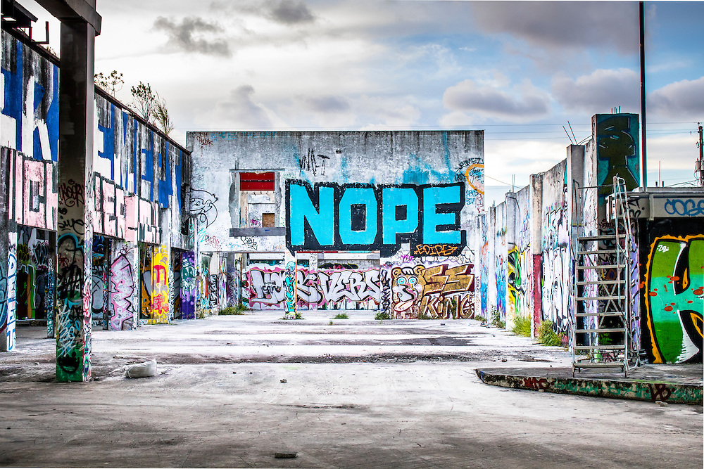 Graffiti, art work and murals cover the former RC Cola bottling plant in Miami's now redeveloping Wynwood arts district. The building is owned now by real estate and arts entrepreneur Moishe Mana who sometimes holds events there