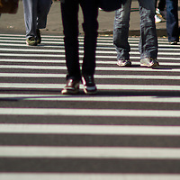 Pedestrians using a crosswalk to cross 7th Avenue in New York City
