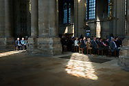 People gather for a Saturday morning service at the cathedral in Reims, France