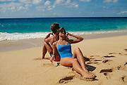 Couple on beach, North Shore, Oahu, Hawaii