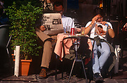 A cafe couple read a copy of Correre della Sera newspaper and a womens magazine in the Italian capital, on 3rd November 1999, in Rome, Italy.