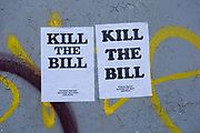 Posters on a graffiti covered wall for a Kill the Bill protest on 6th April 2021 in Birmingham, United Kingdom. Demonstrations have been held all over the UK against the The Police, Crime, Sentencing and Courts Bill, whose legislation, which covers a broad range of issues, would give police more powers in controlling non-violent or static protests and imposing a set of new rules for police to deploy. Protesters see the bill as a disproportionate controls on freedom of expression and their right to protest peacefully.