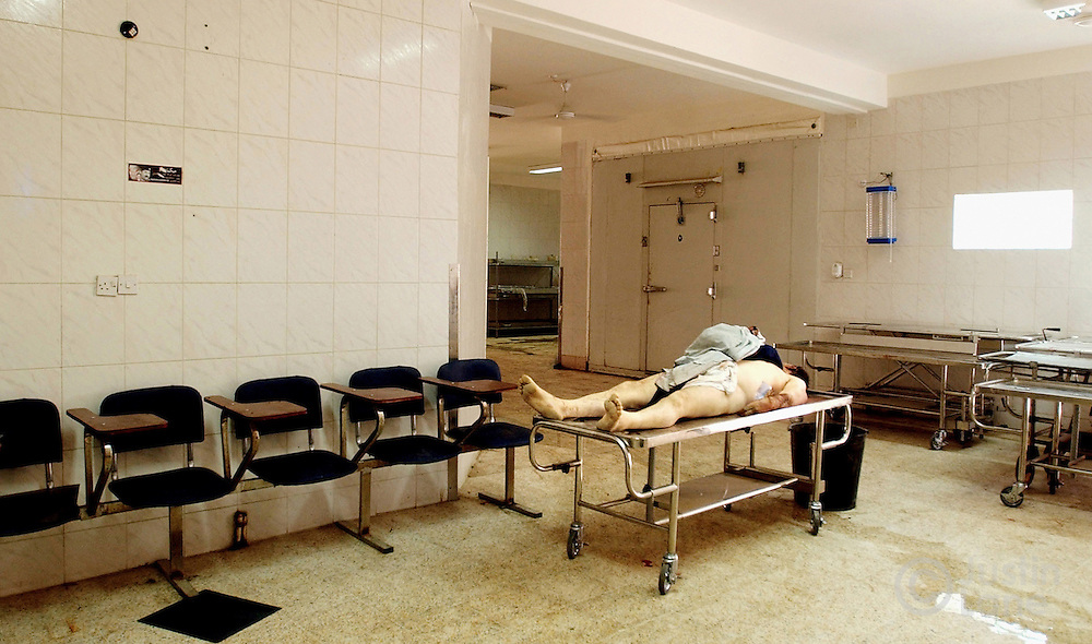 The body of a man killed by gun violence is seen at Baghdad's morgue.