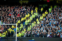 MANCHESTER, ENGLAND - Monday, April 30, 2012: Police separate Manchester City and Manchester United supporters during the Premiership match at the City of Manchester Stadium. (Pic by David Rawcliffe/Propaganda)