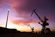 Cranes are silhouetted in Calais docks, France, September 24, 2009. Calais Docks are often the springboard for migrants attempting to illeagally cross the English Channel to the UK.    Picture by Paul Hackett/ Corbis