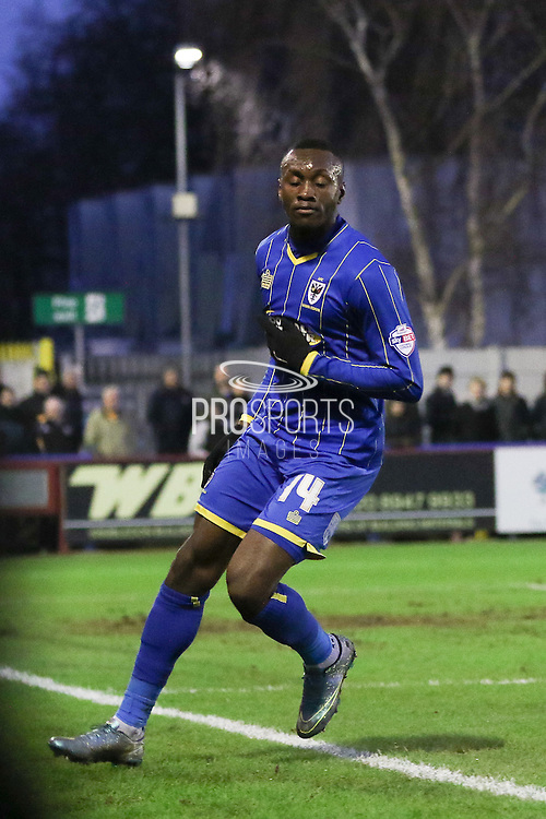 Ade Azeez of AFC Wimbledon after scoring his goal during the Sky Bet League 2 match between AFC Wimbledon and Mansfield Town at the Cherry Red Records Stadium, Kingston, England on 16 January 2016. Photo by Stuart Butcher.