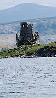 16th century ruin of Ardvreck castle as it sits on edge of Loch Assynt, Scotland