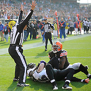 Cleveland receiver Braylon Edwards looks up to side judge Larry Rose on a 28-yard TD pass from Derek Anderson in the third quarter. On the play for Baltimore are Frank Walker (41) and Jim Leonhard.