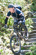 Mountain biker rides down a steep decent Photographed in Tirol Austria