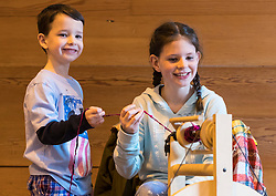 Spinning Workshop during the Scotland-wide World Heritage Day festivities. Six unique events, coordinated by Dig It! 2017, celebrated Scotland's six World Heritage Sites as part of the 2017 Year of History, Heritage and Archaeology. <br /> <br /> Pictured: Olivia Doherty (9) and Will Doherty (6) from Perth taking part in a Spinning Workshop