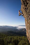 "Jim Thornburg climbing ""Smash and Grab"", a 5.11d sport climb at the Bear Cliff on Mt. St. Helena in Robert Louis Stevenson State Park near Calistoga, California."