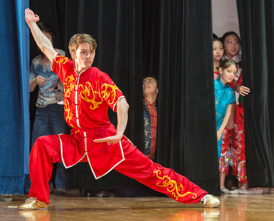 Billy Nisbett performs a Kung Fu demonstration during a district wide celebration of the Chinese New Year at Sharpstown International School, February 22, 2014.
