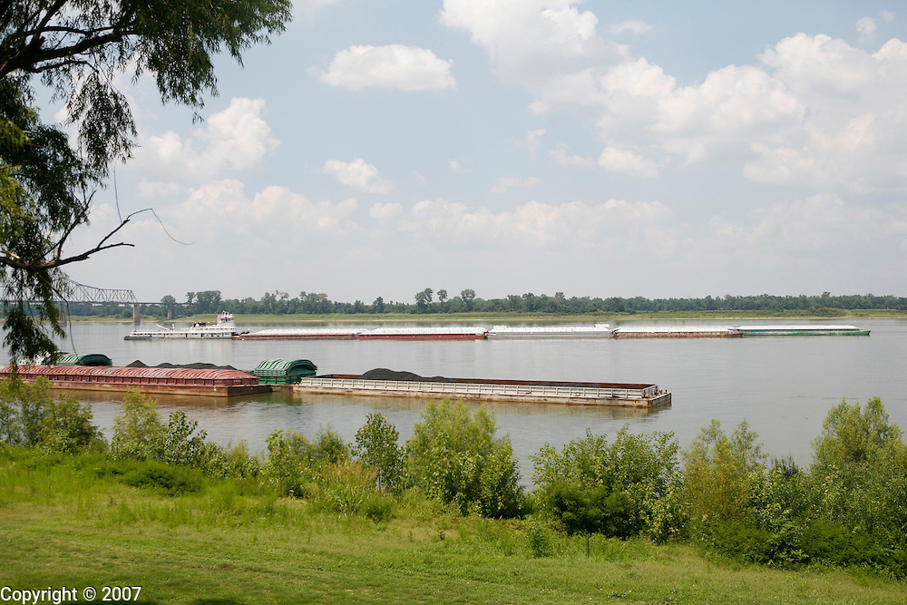 A barge pushes up the Mississippi River where the Ohio and the Mississippi rivers meet seen from Ft. Defiance on the south end of Cairo, Illinois.
