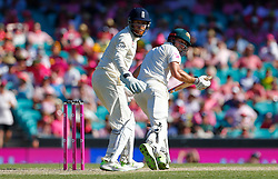 Australia's Shaun Marsh sets off for a run as Jonny Bairstow looks on during day two of the Ashes Test match at Sydney Cricket Ground.