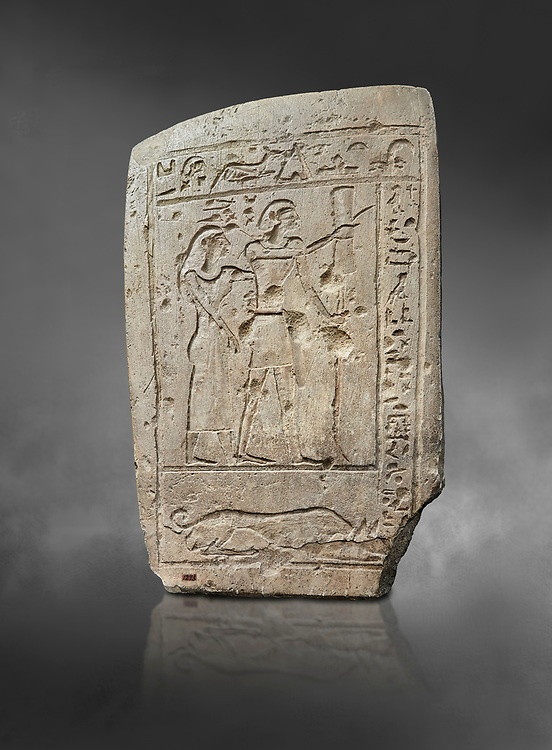 Ancient Egyptian stele of a bowman and his wife, limestone, First Intermediate Period, 7-11th Dynasty, (2118-1980 BC), Deir el-Medina, Schiaparelli cat 1273. Egyptian Museum, Turin. Grey Background .<br /> <br /> If you prefer to buy from our ALAMY PHOTO LIBRARY  Collection visit : https://www.alamy.com/portfolio/paul-williams-funkystock/ancient-egyptian-art-artefacts.html  . Type -   Turin   - into the LOWER SEARCH WITHIN GALLERY box. Refine search by adding background colour, subject etc<br /> <br /> Visit our ANCIENT WORLD PHOTO COLLECTIONS for more photos to download or buy as wall art prints https://funkystock.photoshelter.com/gallery-collection/Ancient-World-Art-Antiquities-Historic-Sites-Pictures-Images-of/C00006u26yqSkDOM