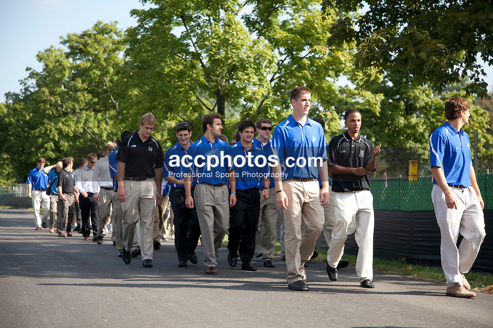 13 September 2010: Duke Blue Devils men's lacrosse at Arlington National Cemetery visit the grave of teammate Jimmy Regan before their reception at the White House after winning the 2010 NCAA National Championship.<br /> <br /> http://www.arlingtoncemetery.net/jjregan.htm