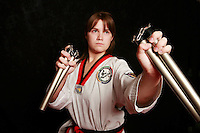 7 February 2008: 16 year old Cassidy Kuehl Tae Kwon Do athlete in motion with Numbchucks weapon. Young kids practicing Taekwondo at the USA Black Belt Academy in Huntington  Beach, CA. Tae Kwon Do is a Korean Martial Art discipline that trains the body and mind.  It is global sport that is an official Olympic sport.