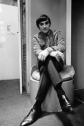 George Best relaxing in his fashion boutique