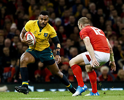 Samu Kerevi of Australia under pressure from Hadleigh Parkes of Wales<br /> <br /> Photographer Simon King/Replay Images<br /> <br /> Under Armour Series - Wales v Australia - Saturday 10th November 2018 - Principality Stadium - Cardiff<br /> <br /> World Copyright © Replay Images . All rights reserved. info@replayimages.co.uk - http://replayimages.co.uk
