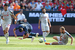 July 28, 2018 - Ann Arbor, Michigan, United States - Ragnar Klavan (17) of Liverpool lands on the field as  Alexi Sanchez (7) of Manchester United falls after losing control of the ball during an International Champions Cup match between Manchester United and Liverpool at Michigan Stadium in Ann Arbor, Michigan USA, on Wednesday, July 28,  2018. (Credit Image: © Amy Lemus/NurPhoto via ZUMA Press)