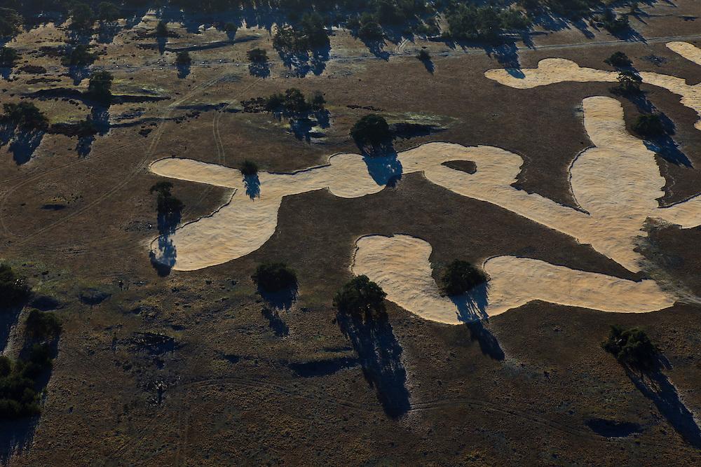 Nederland, Gelderland, Hoge Veluwe, 20-01-2011. Pampelsche  Zand, deel van Nationaal Park de Hoge Veluwe, met hei, vliegdennen en zandverstuivingen. Afgeplagde heide.  gecontroleerd branden. Moorland of the nature area and National Park the Hoge Veluwe. Controlled fires..luchtfoto (toeslag), aerial photo (additional fee required).copyright foto/photo Siebe Swart