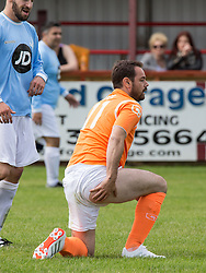 © Licensed to London News Pictures . 02/08/2015 . Droylsden Football Club , Manchester , UK . DANNY DYER takes a tumble . Celebrity football match in aid of Once Upon a Smile and Debra , featuring teams of soap stars . Photo credit : Joel Goodman/LNP