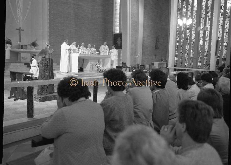 """Fr Niall O'Brien says Thanksgiving Mass.1984..16.07.1984..07.16.1984..16th July 1984..In celebration of his safe homecoming from the Philippines,Fr Niall O'Brien said a thanksgiving mass At Newtownpark Ave,Blackrock,Dublin. Along with two other priests and six lay people,Fr Niall was falsly accused of multiple murders.They became known as """"The Negros Nine"""".After President Reagan visited Ireland,The American government put pressure on the Marcos regime and all charges were dropped and all were fully exonerated...Image of the congregation as the consecration. Fr O'Brien is joined by other Colomban fathers in con-celebration..Note; Fr O'Brien, who was born in Dublin in 1939,died in Pisa, Italy in 2004"""