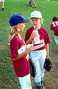 Girls from baseball team age 12 drinking and talking.  St Paul  Minnesota USA
