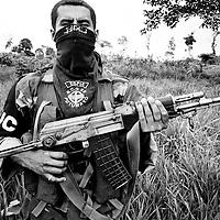 An AUC paramilitary fighter armed with a Kalashnikov assault weapon in a village near La Dorada, Putmayo.