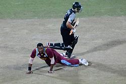 © Licensed to London News Pictures. 01/10/2012. West Indian bowler Kieron Pollard falls on the ground as Ross Taylor runs past  during the T20 Cricket World super 8's match between New Zealand Vs West Indies at the Pallekele International Stadium Cricket Stadium, Pallekele. Photo credit : Asanka Brendon Ratnayake/LNP