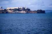 Island of Alcatraz, off the coast of San Francisco, California. Alcatraz Island (sometimes informally referred to as simply Alcatraz or by its pop-culture name, The Rock) is a smaller island located in the middle of San Francisco Bay in California, United States. It served as a lighthouse, then a military fortification, then a military prison followed by a federal prison until 1963. It became a national recreation area in 1972 and received landmarking designations in 1976 and 1986. Today, the island is a historic site operated by the National Park Service as part of the Golden Gate National Recreation Area and is open to tours. Visitors can reach the island by ferry ride from Pier 33, near Fisherman's Wharf in San Francisco...Subject photograph(s) are copyright Edward McCain. All rights are reserved except those specifically granted by Edward McCain in writing prior to publication...McCain Photography.211 S 4th Avenue.Tucson, AZ 85701-2103.(520) 623-1998.mobile: (520) 990-0999.fax: (520) 623-1190.http://www.mccainphoto.com.edward@mccainphoto.com.