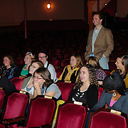 Music Hall programming coordinator Chris Curtis and Members of Arts In Reach watch the rehearsal/sound check of comedy team Women Fully Clothed