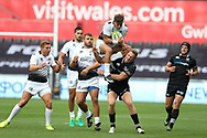 Matteo Minozzi of Zebre Rugby is upended in a tackle from Ben John of the Ospreys, for which Ben John is yellow carded by referee Quinton Immelman (not in picture).Guinness Pro14 rugby match, Ospreys v Zebre Rugby at the Liberty Stadium in Swansea, South Wales on Saturday 2nd September 2017. <br /> pic by Andrew Orchard, Andrew Orchard sports photography.