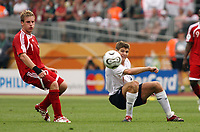 Photo: Chris Ratcliffe.<br /> England v Trinidad & Tobago. Group B, FIFA World Cup 2006. 15/06/2006.<br /> Steven Gerrard from England clashes with Chris Birchall from T&T.