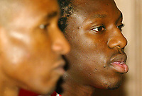 Photo: Scott Heavey.<br />England Press Conference. 29/03/2004.<br />Sean Wright-Phillips (R) and Jermaine Defoe speak to the press