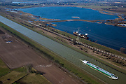 Nederland, Limburg, Gemeente Maasgouw,, 07-03-2010; binnenvaartschip op het Julianakanaal ten oosten van Stevensweert. Het kanaal is aangelegd in het kader van de Maaskanalisatie. Boven een zandwinplas met een oude Maasarm..Barge on the Juliana Canal east of Stevensweert. The canal was built as part of the Meuse Canalization. To the right a lake, result of Sand extraction..luchtfoto (toeslag), aerial photo (additional fee required).foto/photo Siebe Swart