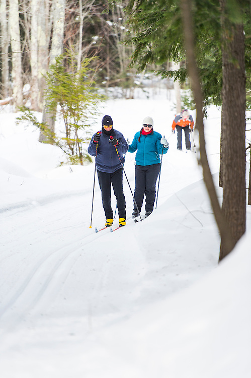 Participants in the Michigan DNR Becoming an Outdoors Woman program learn nordic skiing at Bay Cliff Health Camp in Big Bay, Michigan.