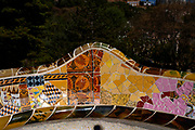 Serpentine bench, Parc Guell, Barcelona, Catalonia, Spain. A public park design by famed Catalan architect Antoni Gaudi featuring gardens and architectural curiosities.
