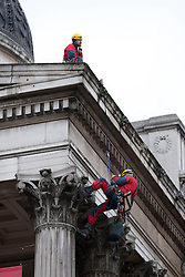 © Licensed to London News Pictures. 21/02/2012. LONDON, UK. Greenpeace activists are seen hanging from the National Gallery in London today (21/02/12) as they take part n a protest there. The protest was held to correspond with a Shell Petroleum event being held at the gallery this evening. Photo credit: Matt Cetti-Roberts/LNP
