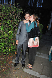 JAMES ROTHSCHILD and his sister KATE GOLDSMITH at a Summer party hosted by Lady Annabel Goldsmith at her home Ormeley Lodge, Ham, Surrey on 14th July 2009.