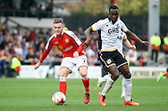 Crewe Alexandre's Matt Tootle gets to the ball ahead of  Port Vale's Jordan Slew. Skybet football league one match, Crewe Alexandra v Port Vale at the Alexandra Stadium in Crewe on Saturday 13th Sept 2014.<br /> pic by Chris Stading, Andrew Orchard sports photography.