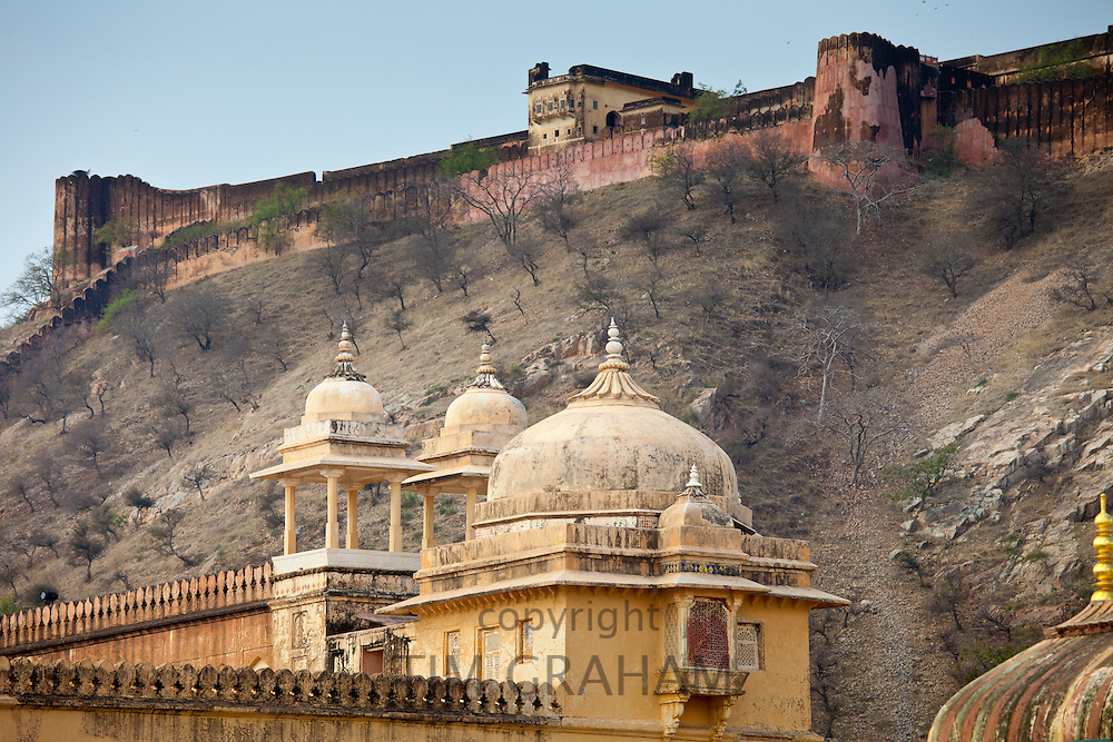 Chattri at The Amber Fort a Rajput fort built 16th Century in Jaipur with 11th Century Jaigarh Fort behind in Rajasthan, India