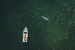 THEMENBILD - eine Schwimmerin und ein Boot am Zeller See, aufgenommen am 01. August 2020 in Zell am See, Österreich // a swimmer and a boat at the Zeller See, Zell am See, Austria on 2020/08/01. EXPA Pictures © 2020, PhotoCredit: EXPA/ JFK