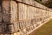 Tzompantli or Skull Platform in Chichen Itza, a large pre-Columbian city built by the Maya others show a scene with a human sacrifice; eagles eating all human hearts; and skeletonized warriors with arrows and shields.