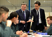 © Licensed to London News Pictures. 14/02/2013. Bedford, UK. Ed Balls (left and Ed Miliband talkto apprentices. Ed Miliband MP, Leader of the Labour Party, delivers a major speech at Bedford Training Group in Bedford today, 14th February 2013. In the speech he set out a 'One Nation Labour agenda for rebuilding Britain's economy'. The speech was followed by a Q&A session with Ed Balls, Shadow Chancellor and a tour of the training facility. Photo credit : Stephen Simpson/LNP