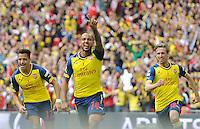CELE - Arsenal's Theo Walcott celebrates scoring the opening goal <br /> <br /> Photographer Ashley Crowden/CameraSport<br /> <br /> Football - The FA Cup Final - Aston Villa v Arsenal - Saturday 30th May 2015 - Wembley - London<br /> <br /> © CameraSport - 43 Linden Ave. Countesthorpe. Leicester. England. LE8 5PG - Tel: +44 (0) 116 277 4147 - admin@camerasport.com - www.camerasport.com