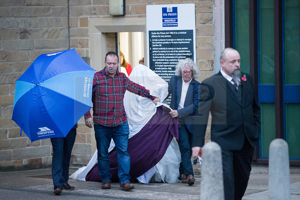 © Licensed to London News Pictures. 14/11/2017. Wakefield UK. Ex Coronation Street actress Paula Williamson leaves Wakefield prison this evening covered with a white blanket after marrying Britains most violent prisoner Charles Bronson. Photo credit: Andrew McCaren/LNP